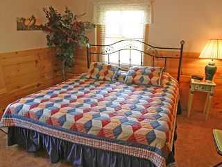 bedroom in cabin 103 knotty pine in pigeon forge tennessee