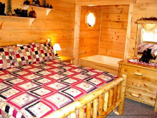 country bedroom in cabin 216 bearly county in pigeon forge