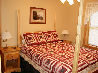 one of 5 country bedrooms in cabin 234 dancing bear lodge at eagles