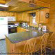 Large country kitchen with bar in cabin 241 (Eagle Crest Lodge) at Eagles Ridge Resort at Pigeon Forge, Tennessee.