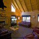 Large living room with vaulted ceiling and fireplace in cabin 241 (Eagle Crest Lodge) at Eagles Ridge Resort at Pigeon Forge, Tennessee.
