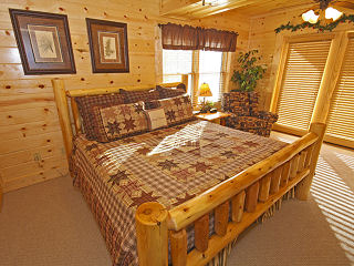 bedroom in cabin 244 blackhawk hideaway in pigeon forge tennessee