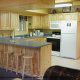 Country kitchen with bar in cabin 298 (Renewed Spirit) at Eagles Ridge Resort at Pigeon Forge, Tennessee.