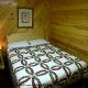 Country bedroom in cabin 304 (Southern Hospitality) at Eagles Ridge Resort at Pigeon Forge, Tennessee.