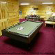 Game room with pool table in cabin 304 (Southern Hospitality) at Eagles Ridge Resort at Pigeon Forge, Tennessee.