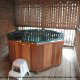 Porch with hot tub in cabin 304 (Southern Hospitality) at Eagles Ridge Resort at Pigeon Forge, Tennessee.