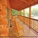 Front deck with rocking chairs in cabin 305 (Bear Right In) at Eagles Ridge Resort at Pigeon Forge, Tennessee.