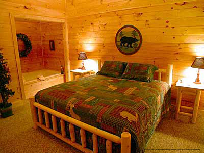 bedroom in cabin 310 country bear cove in pigeon forge tennessee