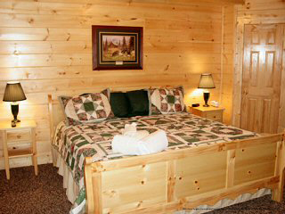country bedroom in cabin 316 black bear hideaway in pigeon forge
