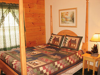 poster bed in cabin 65 eagles point in pigeon forge tennessee