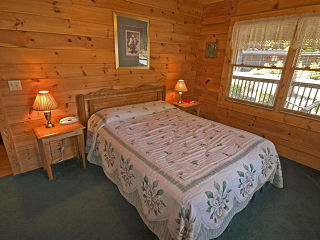 country bedroom in cabin 76 bear tracks in pigeon forge tennessee