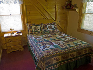 bedroom in cabin 78 the bear cabin in pigeon forge tennessee