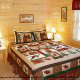 Country bedroom in cabin 815 (As Good As it Gets) at Eagles Ridge Resort at Pigeon Forge, Tennessee.