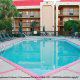 Outdoor Pool with Chaise Lounge Chairs at the Hampton Inn Hotel in Gulfport, near Biloxi, Mississippi.