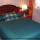 Another country decorated bedroom at the Country Pines Log Home Resort in Pigeon Forge Tennessee
