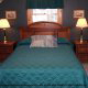 A master bedroom in blue at the Country Pines Log Home Resort in Pigeon Forge Tennessee