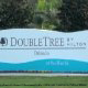 Logo Sign View at DoubleTree by Hilton Hotel Orlando at SeaWorld in Orlando, Florida. Enjoy quality accommodations in this charming location during your New Years Family Getaway.