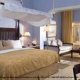 King size bed in ocean front junior suite at Gran Melia Gulf Resort, Rio Grande, Puerto Rico.