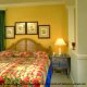 Bedroom furnished with tropical decor for a perfect vacation to the Grand Beach Resort Condos in Orlando Florida