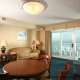 Dining and living room view of a one bedroom suite at The Best Western Carolinian in Myrtle Beach
