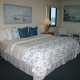 Ocean Trillium Suites king bed