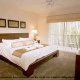 Fresh clean master bedroom suite at the Palisades Resort in Orlando, Florida.