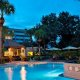 Have fun and relax,  after a day at the parks,  in our tropically landscaped outdoor pool.