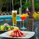 Enjoy light fare and tropical drinks poolside at Evergreen Poolside.