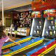 Kids enjoy fun at the arcade during summer vacation to the Wilderness Stone Hill Lodge in Pigeon Forge Tennessee.