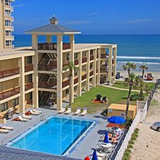 $139 | Coastal Waters Inn | Labor Day New Smyrna Beach Vacation | Deluxe Hotel Room | 4 day 3 night | $50 Dining Dough